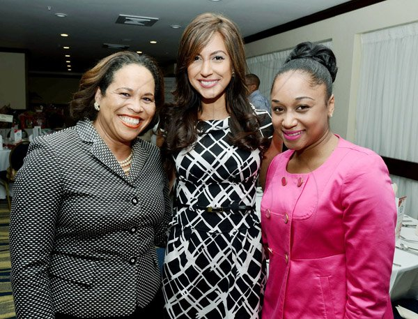 Rudolph Brown/Photographer Sharing lens time are the gorgeous trio of (from left) Anne Marie Stewart of VIP Attractions,  Kerrie Baylis of RCW Capital  and Digicel's Renee Reid.