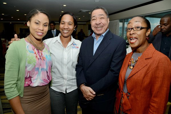 Rudolph Brown/Photographer Capt. Lloyd Tai, Fly Jamaica pose with from left Ayanna Kirton, Simone Johnson of Gas Pro and Rene Allen Casey, Professional Services Manager of CSS at the AMCHAM Digicel Christmas  luncheon EXTRAVAGANZA at the Jamaica Pegasus Hotel on Thursday, December 5, 2013