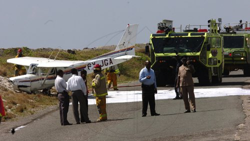 Norman Grindley/Chief Photographer This single engine plane shot the run way at the Norman Manley international air port in Kingston and crash on the Port Royal road about 10:25 am  March 4, 2011. The pilot and another passenger were taken to hospital.