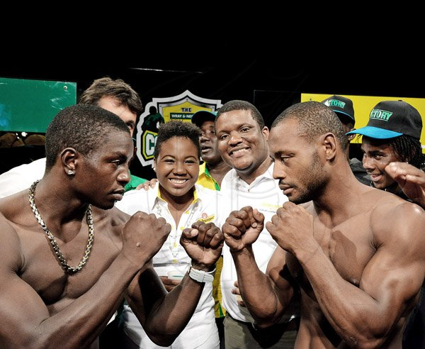 Winston Sill/Freelance Photographer Guyana's Derick 'Dangerous' Richmond (left) of the Yellow Team squares off with Jamiaca's Sakima Mullings (Green Team at the launch of this year's J Wray and Nephew White Overproof Rum Contender Series at TVJ Studios, Lyndhurst Road, St Andrew on Thursday night. Also in photograph are Chloe DaCosta (second left), brand manager, Schweppes and Cecil Smith (second right), group brand manager- rum, J Wray and Nephew.