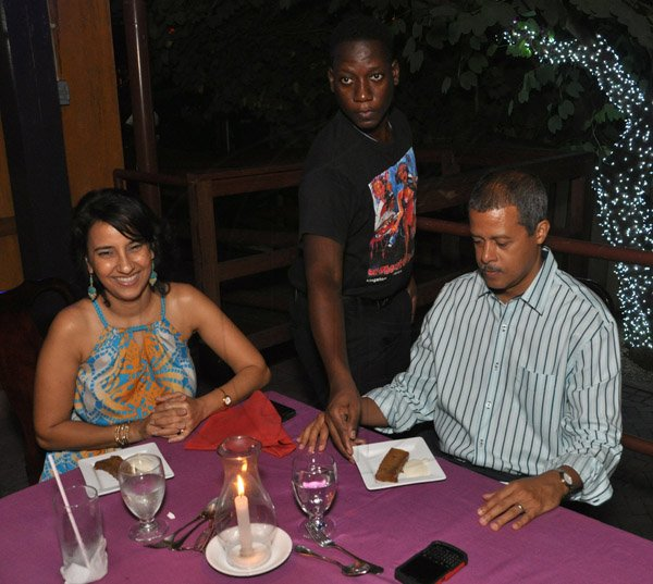 Jermaine Barnaby/Photographer Robin Williams (right) and Rene Williams being served at The Gleaner's Pre-Restaurant Week Dinner Promotions 2013 with Karin Cooper and guests at  Red Bones on   Tuesday, November 5, 2013.