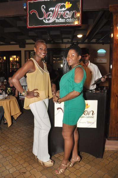 Jermaine Barnaby/Photographer Jennifer Small (left) radio personality and her guest Yvette Dewar Finance manager Illuminat Jamaica were out for Restaurant week at Saffron Indian cuisine, Market Place on Tuesday November12, 2013.