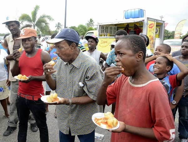 Gladstone Taylor / Photographer  dumpling eating contest as seen at the Gleaner company food moth promotion held at shoppers fair super market on brunswick avenue, spanish town on saturday