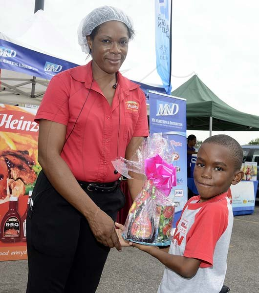 Gladstone Taylor / Photographer  David Hamilton claims first prize in the Hoola hoop competition as seen at the Gleaner company food moth promotion held at shoppers fair super market on brunswick avenue, spanish town on saturday
