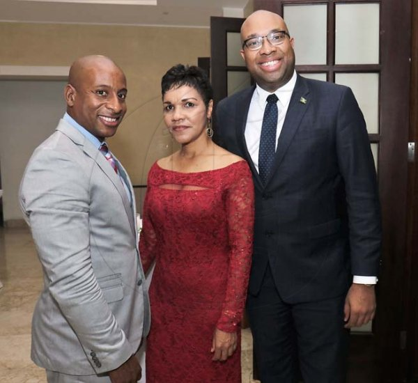 Ashley Anguin photo<\n>From Left- Omar Robinson (JHTA President) poses with Barbara Burton (GM Jewel Grande Resorts) and Delano Seiveright  (Senior Advisor Jamaican Government) <\n><\n><\n><\n>