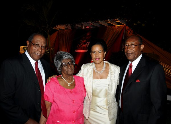 "Winston Sill / Freelance Photographer Launch of Dr. Henry Lowe Autobiography titled ""It Can Be Done"", held at Eden Gardens, Lady Musgrave Road on Wednesday night November 28, 2012. Here are Dr. Herbert Lowe (left), brother; Josephine Lowe (second left), mother; Janet Lowe (second right), Henry's wife; and Dr. Henry Lowe (right)."