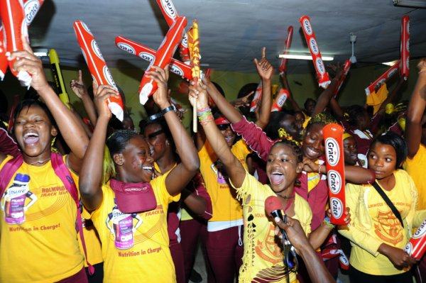 Norman Grindley/Chief Photographer Holmwood Technical  High school  students  continue to celebrate their victory at their Manchester school Auditorium April 4, 2011. The school won the girls championship at the  ISSA/Gracekennedy Boys and Girls Championship last Saturday at the National Stadium.