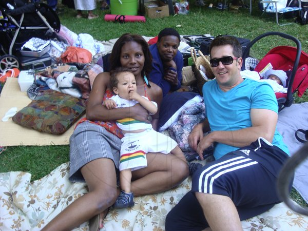 The Steinberg family baby Tuvia, dad Jason, his wife Jacqueline and her aunt Audrey relaxes at the Jamaica  50th Fun Day and Picnic