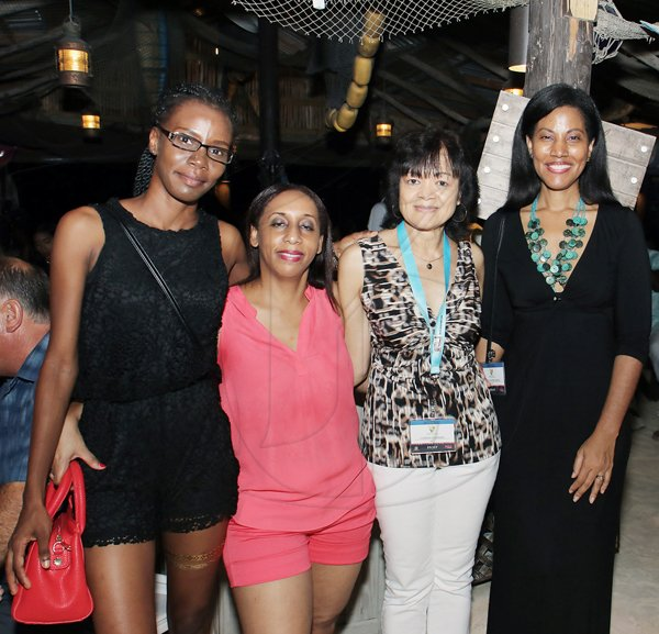 Ashley Anguin<\n>From left: Sania Brown, Shelly-Ann Treasore, Camille Needham and Nicola Madden -Greig pause their partying to smile for our lens. <\n> *** Local Caption *** @Normal:From left: Sania Brown, Shelly-Ann Treasore, Camille Needham, and Nicola Madden-Greig pause their partying to smile for our lens.