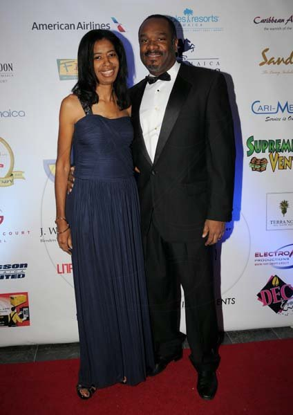 "Winston Sill/Freelance Photographer The Jamaica Chamber of Commerce (JCC) Civic Affairs Committee present its annual Grand Charity Ball, under the theme ""Dream the Possible  Dream"", held at the Jamaica Pegasus Hotel, New Kingston on Saturday night November 2, 2013.Here are Winston Lawson and wife ---???."