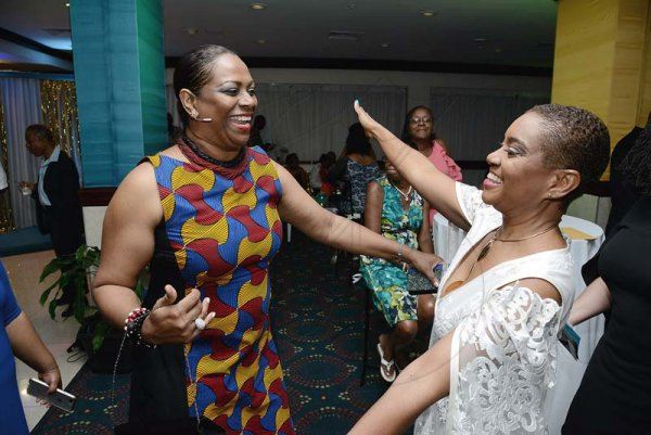 Rudolph Brown/ Photographer<\n>Patsy Latchman Atterbury (left), of Scotiabank, greets birthday girl Joan Forrest-Henry.<\n>at her 25/25 birthday celebration with families and friends at the Jamaica Pegasus Hotel in New Kingston on Saturday, June 30, 2018<\n>