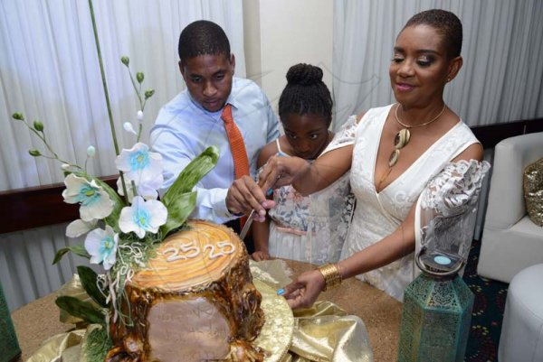 Rudolph Brown/ PhotographerBirthday girl Joan Forrest-Henry, cutting her cake with kids Brandon and Kaelia Henry at her 25/25 birthday celebration with families and friends at the Jamaica Pegasus Hotel in New Kingston on Saturday, June 30, 2018