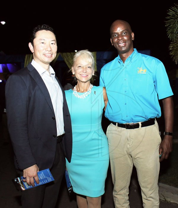 *** Local Caption *** Starting from left- Seiji Kawamura (Chairman of the Board, JPS) poses with Kelly Tomblin (CEO and President, JPS) and Keith Garvey (VP Customer Service and Communications)