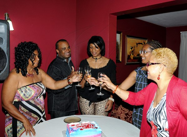 Winston Sill / Freelance Photographer Ian Lyn host  Birthday Party for June Daley, President of Miss Jamaica UK Pageant, held at Waterworks Road on Monday night February 4, 2013. Here are (June Daley's aunt)?? (left); Ian Lyn (second left); June Daley (centre); Erica Myers-Tattersall (second right); and Sharon Lue-Moncrieffe (right).