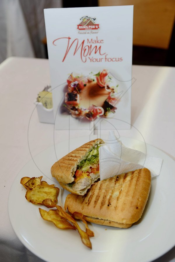 Rudolph Brown/Photographer Hamilton smoked chicken breast Paninis at Susie's Cafe Mother's Day Brunch on Sunday, May 11, 2014