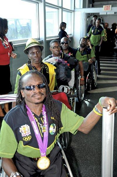 Jamaica GleanerGallery Paralympians Arrive Norman Grindley ...