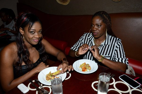 Winston Sill/Freelance Photographer Restaurant Week ambassador Camille Davis  and guest ----????  dine, at 689 Brian Lumley, Trinidad Terrace, New Kingston  on Monday night November 17, 2014. Here are Camille Davis (left); and ----??? (right).