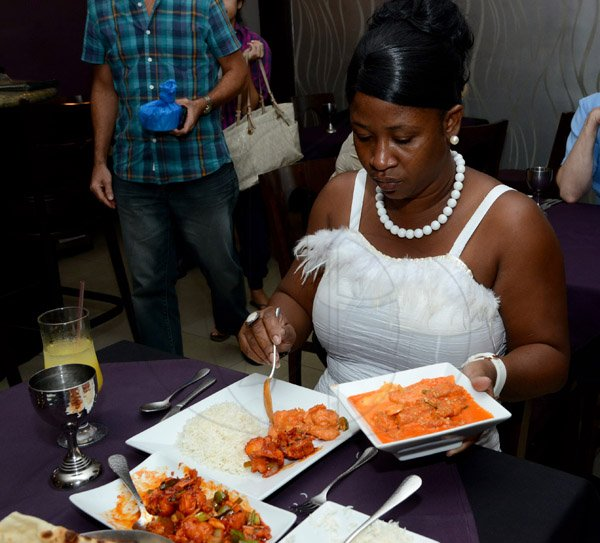 Winston Sill/Freelance Photographer  Tessanne Chin Concert Prize winner, Stacy Ann Hemmings-Wallace as she digs into her Fish singapori