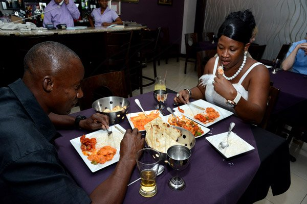 Winston Sill/Freelance Photographer  Stacy Ann Hemmings-Wallace as she dines with her husband Oneil Wallace