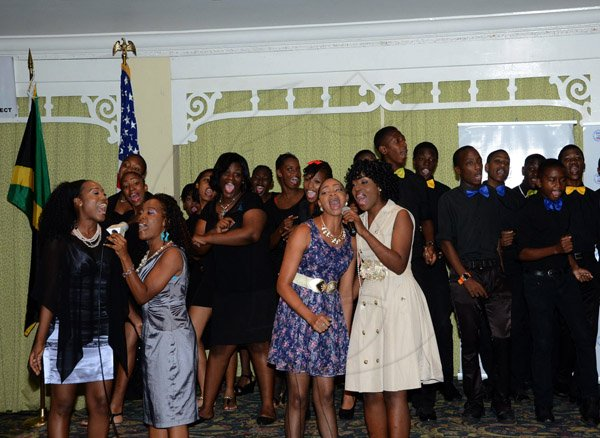 Winston Sill/Freelance Photographer USAID/Jamaica host Appreciation Reception for their various partners and the private sector, for over 52 years, held at the Knutsford Court Hotel, Ruthven Road on Tuesday night December 9, 2014. Here members of Vauxhall High School Choir in performance.