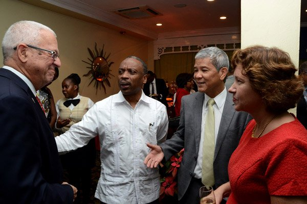 Winston Sill/Freelance Photographer USAID/Jamaica host Appreciation Reception for their various partners and the private sector, for over 52 years, held at the Knutsford Court Hotel, Ruthven Road on Tuesday night December 9, 2014. Here are Minister of Education Ronald Thwaites (left); Milton Samuda (second left); Kevin Hendrickson (second right); and Elizabeth Martinez (right), Charge d' Affaires, US Embassy.