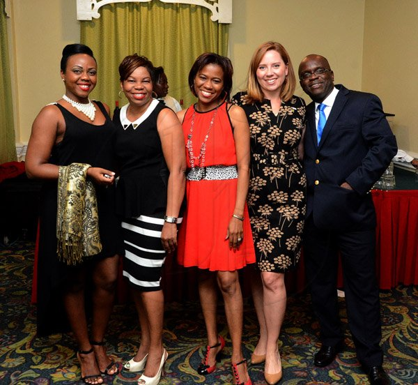 Winston Sill/Freelance Photographer USAID/Jamaica host Appreciation Reception for their various partners and the private sector, for over 52 years, held at the Knutsford Court Hotel, Ruthven Road on Tuesday night December 9, 2014. Here are Marcia Whyte (left); Joan Campbell (second left);  Simone Sewell-Walker (centre); Suzanne Ebert (second right); and Kenneth Williams (right), all staff members, USAID.